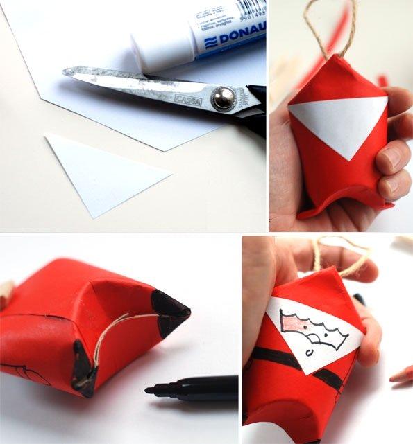 Bạn cắt một hình tam giác cân bằng giấy màu trắng rồi dùng bút dạ vẽ mặt cho ông già Noel.